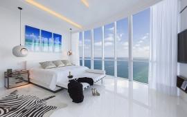 Incredible Designer bedroom with white floor next to Ocean. Cont